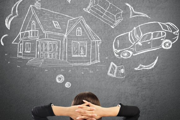 Mortgage and credit concept. Young woman planning her future